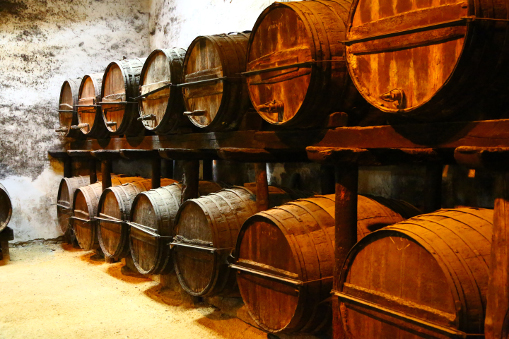 Since when has wine been stored in barrels?