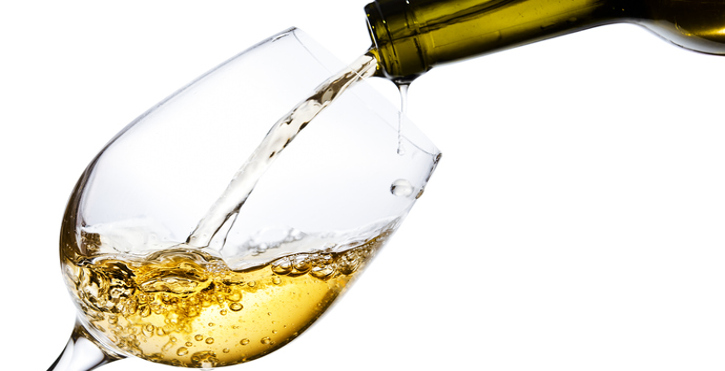 Why is it that white wine has its characteristic colour?
